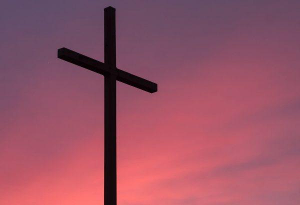 brown wooden cross during golden hour